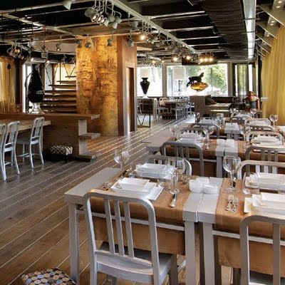 Industrial design style restaurant using vintage Emeco old navy